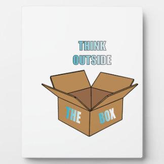 Denken Sie außerhalb des Kastens Fotoplatte