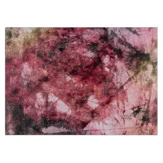 Der Farbenbürste des roten schwarzen Grunge Schneidebrett