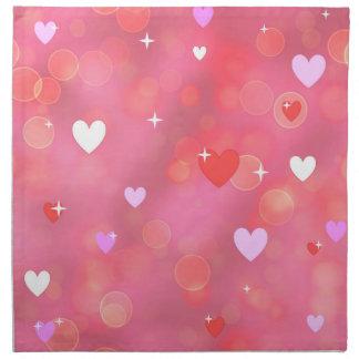 Der Hintergrund des Valentinsgrußes Stoffserviette