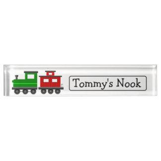 Der personalisierte Name des Kindes und Schreibtischplakette
