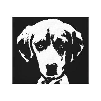 Der schwarze Beagle u. das Weiß wickelten Leinwanddruck