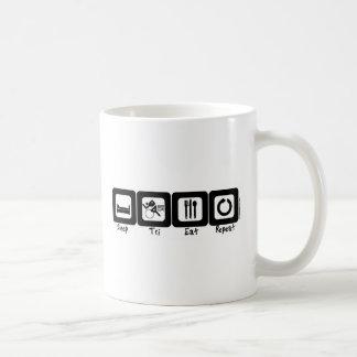Der Tri Schlaf isst Wiederholung Kaffeetasse