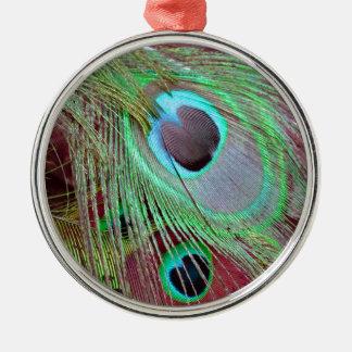 Die flüssige Feder des Pfaus des blauen Auges Silbernes Ornament