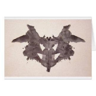 Die Rorschach Test-Tinte befleckt Schläger der Karte