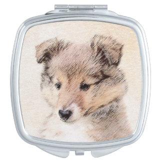 Die Shetlandinseln-Schäferhund-Welpe, der Schminkspiegel