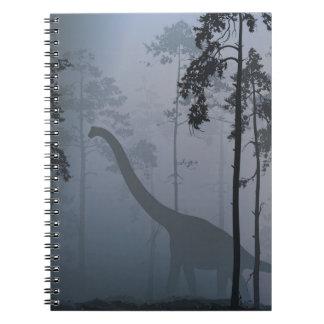 Dinosaurier durch Mondschein-Notizbuch Notizblock