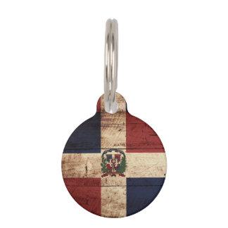 Dominikanische Republik-Flagge auf altem hölzernem Tiernamensmarke