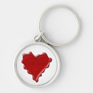 Dominique. Rotes Herzwachs-Siegel mit Schlüsselanhänger