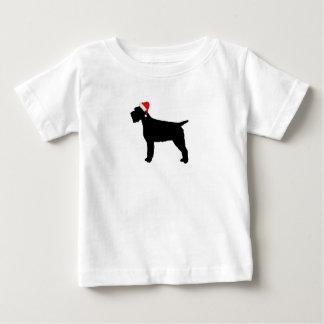 Drahthaar, das Griffon Hund mit roter Baby T-shirt