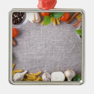 Draufsicht der Bestandteile für eine Mahlzeit Quadratisches Silberfarbenes Ornament