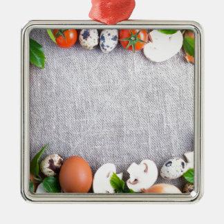Draufsicht der Lebensmittelinhaltsstoffe in der Quadratisches Silberfarbenes Ornament