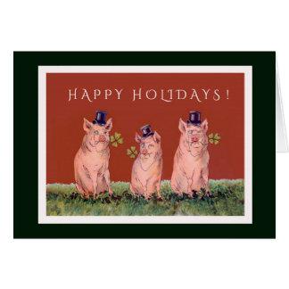 Drei entzückende Schweine, die frohe Feiertage Sie Karte