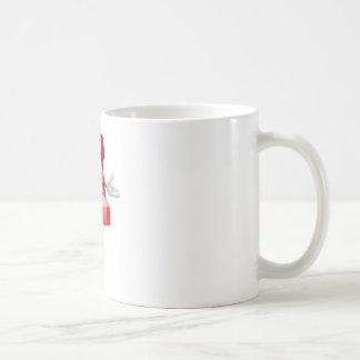 Drücken Sie ButtonBürozubehörmaskottchen Tasse