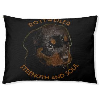Dunkler niedlicher Rottweiler Welpen-Hund Haustierbett