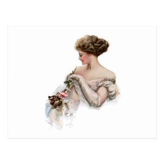 Ehrlich neckt Mädchen ein Kätzchen Postkarte