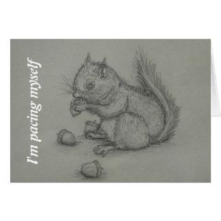 Eichhörnchen, das den Nuts Bleistift zeichnet Kart Grußkarte