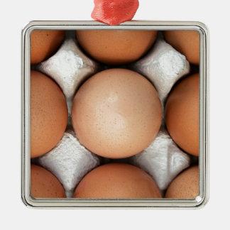Eier in einem Kasten Quadratisches Silberfarbenes Ornament