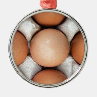 Eier in einem Kasten Rundes Silberfarbenes Ornament