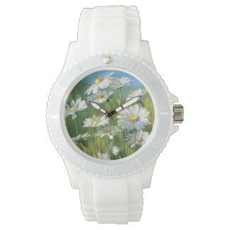 Ein Feld der weißen Gänseblümchen Uhr