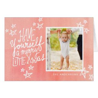 Ein fröhliche kleine Weihnachtshandmit buchstaben Karte