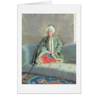 Ein Herr gesetzt auf einer Couch Karte