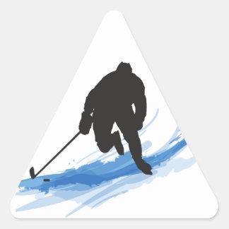 Ein Hockey-Spieler auf Eis Dreieckiger Aufkleber