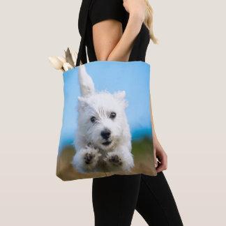 Ein niedlicher Westhochland-Terrier-Welpen-Betrieb Tasche