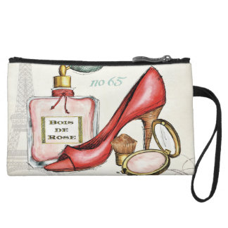Ein roter Schuh, eine Flasche Parfüm und erröten Wristlet
