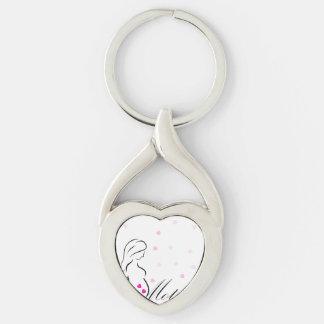 Ein schwangeres Mutter-zu-ist mit rosa Schlüsselanhänger