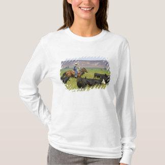 Ein Viehzüchter zu Pferd während einer T-Shirt