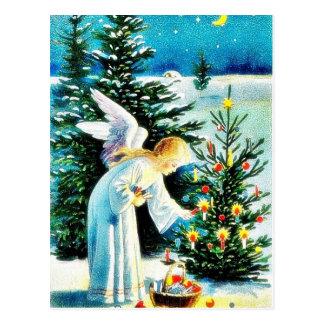 Ein Weihnachtsgruß mit einem Engels-Setfeuer auf a Postkarte