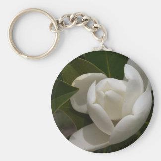 eine cremefarbene Magnolien-Blumenknospe Schlüsselanhänger
