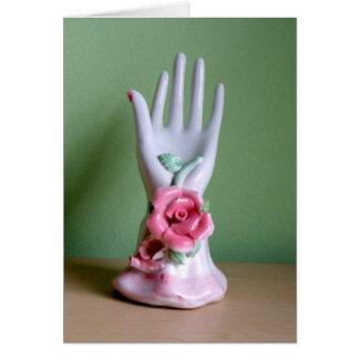 Eine dekorative Porzellan-Hand mit Rosen Karte