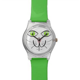 Eine grüne mit Augen Katzen-justierbare Uhr