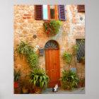 Eine Katze sucht Eingang zum Zuhause in Pienza, It Poster