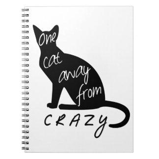 Eine Katze weg von VERRÜCKTEM Notizblock
