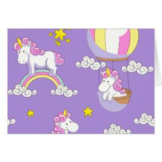 Einhörner in den Ballonen auf Regenbogen und auf Karte