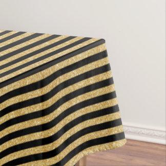 Eleganter GoldGlitter und schwarzes Tischdecke