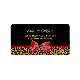 Eleganter Goldleopard-Druck mit rotem Adressaufkleber