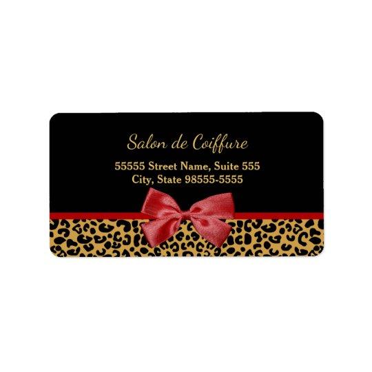 Eleganter Goldleopard-Druck mit rotem Adressetiketten