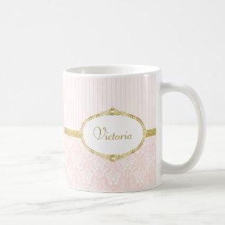 Eleganter rosa Damast-Vintager Goldrahmen und Kaffeetasse