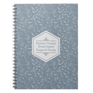 Elegantes Grau-Blätter auf Vintagem Blau Notizblock