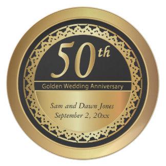 Elegantes Schwarzes und goldener Jahrestag des Teller