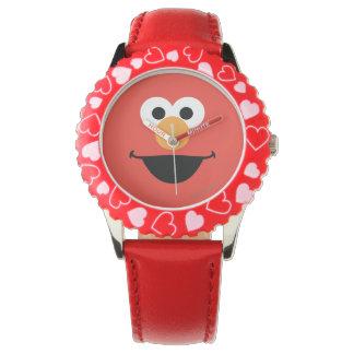 Elmo stellen Kunst gegenüber Uhr