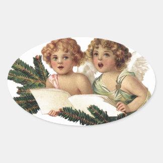 Engel, die Liede singen Ovaler Aufkleber
