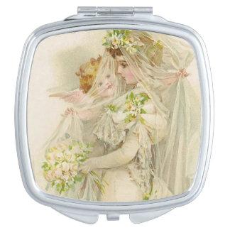 Engel justiert den Schleier der Braut, Schminkspiegel