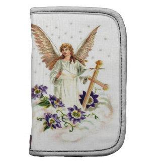 Engel mit Kreuz-und Clematis-Blumen Planer