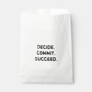 Entscheiden Sie. Legen Sie fest. Folgen Sie. Geschenktütchen