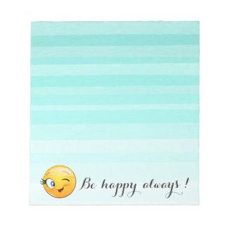 Entzückender blinzelnder smiley Emoji Gesicht-Ist Notizblock