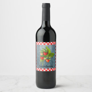 Erdbeeren auf Denim-und Gingham-Blick-Hintergrund Weinetikett
